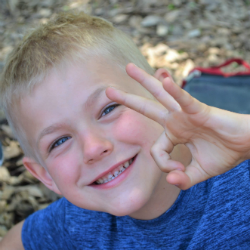 Smiling kid giving the OK sign