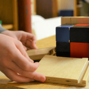 Kids hands working with blocks